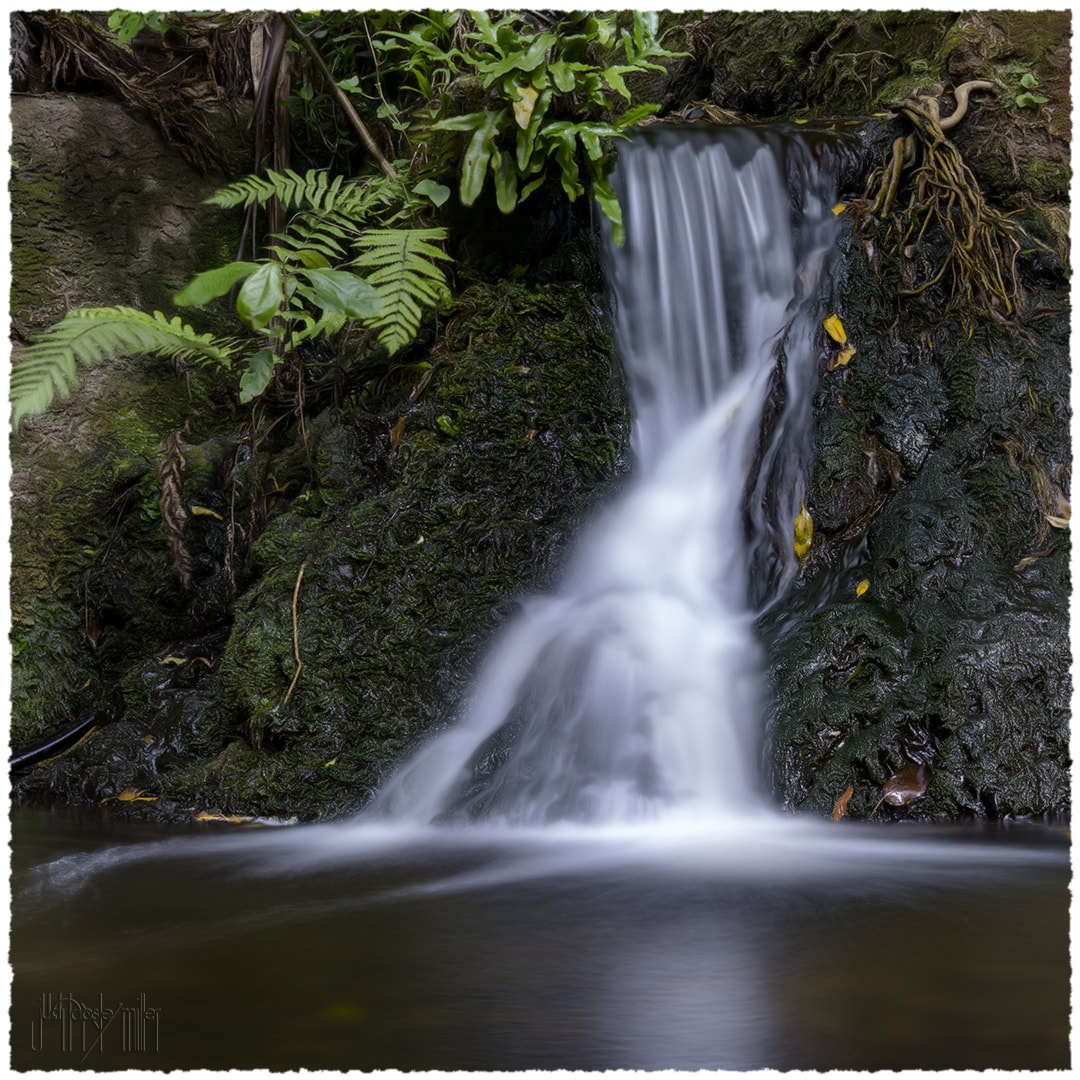 Photo of a small waterfall taken with a slow shutter speed